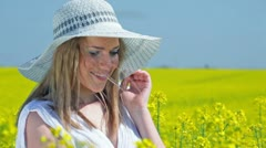 Women smiling and posing on field of rapeseed Stock Footage