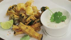 Pakoras (fried vegetables in chickpeas batter, India) Stock Footage