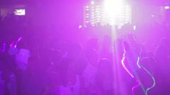 Big light illuminates a crowd at the disco Stock Footage