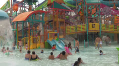 Unrecognizable People at a Waterpark's Children's Play Area Stock Footage