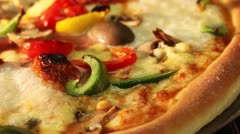 A vegetarian pizza in an oven (close-up) - stock footage