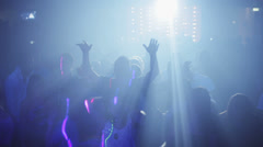 Overview of a crowd at the disco, illuminated from the stroboscopic lights Stock Footage