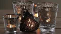 Tea lights and a decorative heart Stock Footage