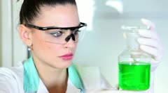 Young woman doing experiment - stock footage