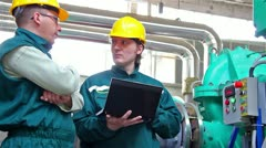 Industrial workers with a notebook Stock Footage