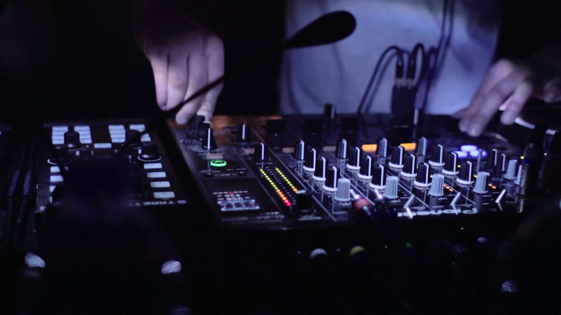 Download Dj Mixer Work 2048 X 2048 Wallpapers: A DJ Plays With The Mixer In Disco