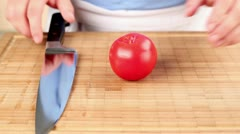 A tomato being chopped - stock footage