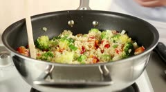 Vegetable couscous being sprinkled with parsley - stock footage