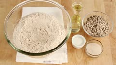 Ingredients for sunflower seed bread (wholemeal flour, sunflower oil, sunflower - stock footage