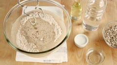 Ingredients for bread dough being kneaded with a food processor Stock Footage