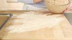 Bread dough being shaped into a loaf on a floured work surface Stock Footage