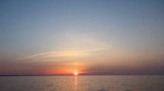 Sunset on the sea,  the sun on the horizon, windless weather Stock Footage