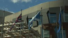 Flags at Scottish Parliament.50Mbs Stock Footage