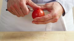 A tomato being peeled Stock Footage