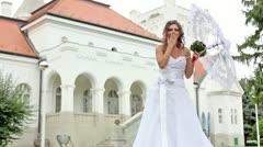 Happy, beautiful bride sending a kiss Stock Footage