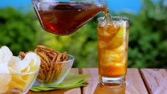 Iced tea at a picnic - stock footage