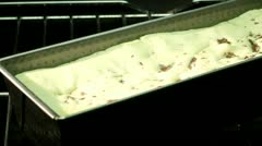 A cake being baked in a loaf tin in the oven (time lapse) Stock Footage