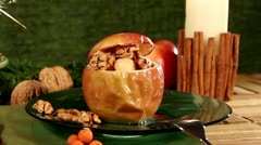 A baked apple on a table decorated for Christmas, with a sparkler Stock Footage