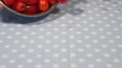 Teardrop tomatoes being tipped onto a table Stock Footage