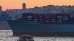Container ship cruising past the city skyline Stock Footage
