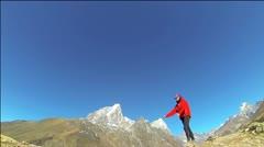 Woman doing cartwheel at Himalayas Stock Footage