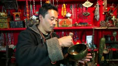 Seller in traditional tibetian store Stock Footage
