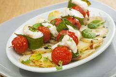 white fish kebabs monkfish cherry tomatoes snow peas - stock photo