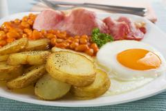 saute potatoes with bacon egg and beans - stock photo