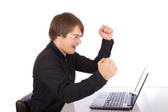 business man raises arms in front of his laptop - stock photo