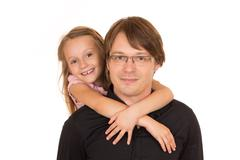 Father giving piggyback ride Stock Photos