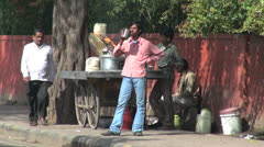 Delhi street with a food and drink sales cart Stock Footage