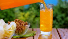 Pouring orange soda at picnic - stock footage