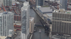 Boat passing on Chicago River, Aerial view of Downtown Chicago Skyline Sun Times Stock Footage