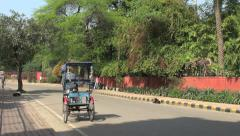 Delhi street with bicycle rickshaw s1 Stock Footage