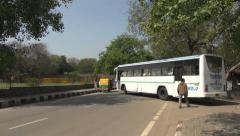 India Delhi bus at Qutub Minar  Stock Footage