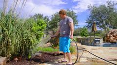 Man watering garden plants Stock Footage