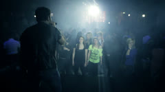 People dancing in a disco on the vocalist sound Stock Footage