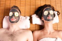 Couples retreat facial mask spa Stock Photos