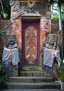 Gates of the old temple with stone guards. indonesia, bali. Stock Photos