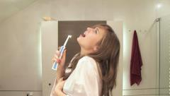 Girls bathroom routine Stock Footage
