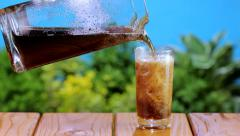 Pouring cola into a glass - stock footage