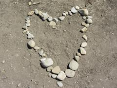 Heart Made From Rocks On Beach Stock Photos