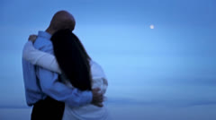 A closely slung love couple under a full moon 3 - stock footage