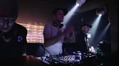 Three djs do entertainment, for people in a disco Stock Footage