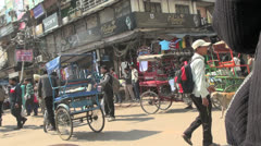 Delhi bicycle rickshaw ride past shops and people Stock Footage