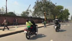 Delhi bicycle rickshaw ride with motor bikes - stock footage
