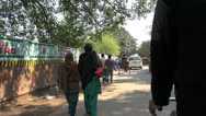 Stock Video Footage of Delhi people walking seen from bicycle rickshaw ride