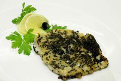 Fish food Stock Photos