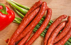 Any sausage on green onion Stock Photos