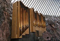 A historic pipe organ in church in rock Stock Photos